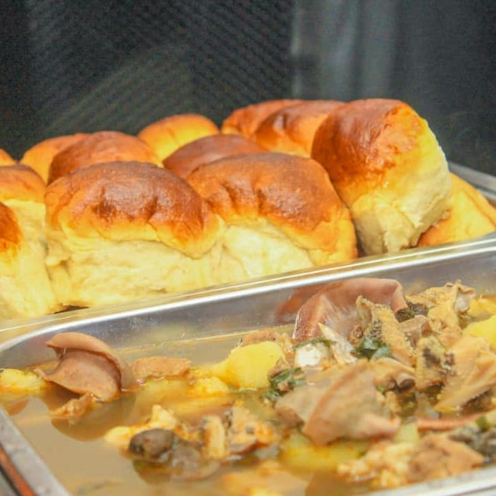 chicken soup with bread rolls