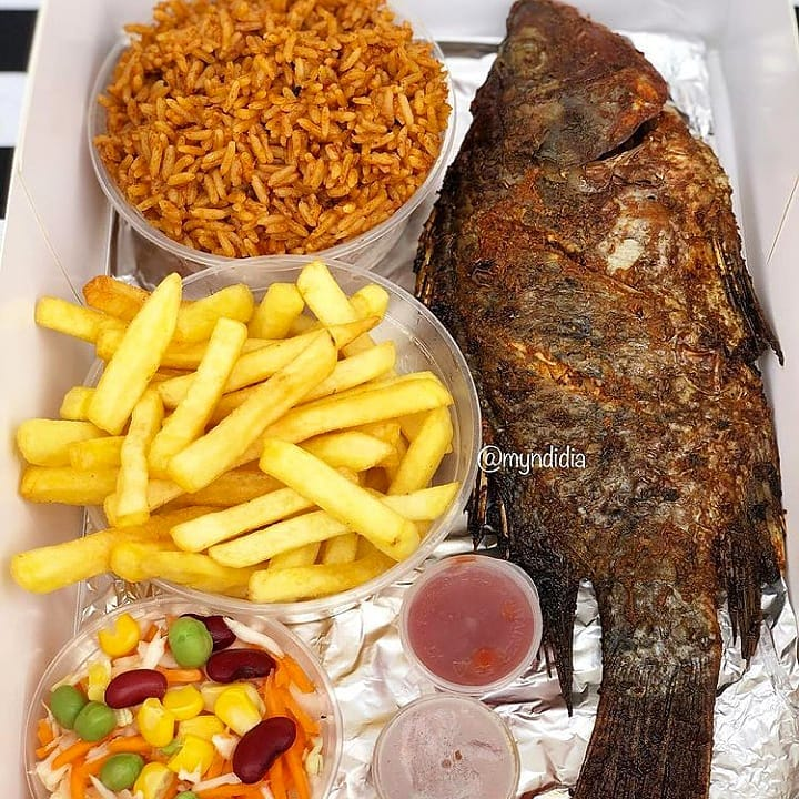 croaker fish with chips and jollof rice